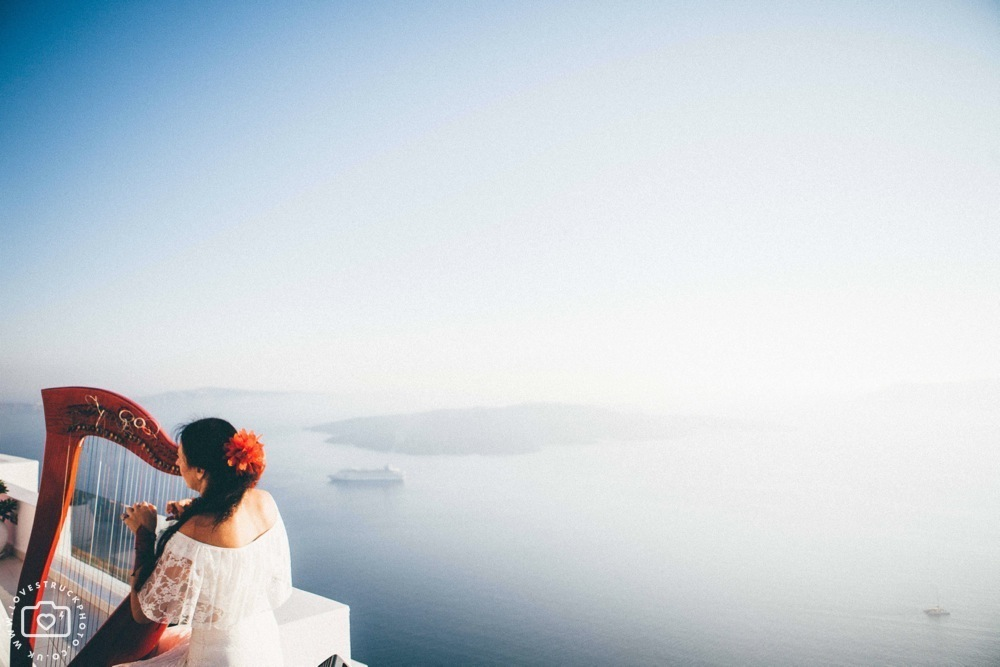 fira sunset wedding ceremony santorini, santorini sunset wedding ceremony, fira wedding photographer