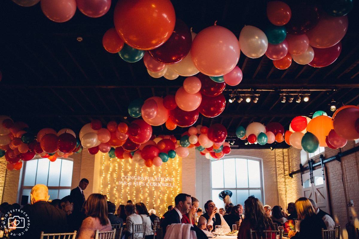 trinity buoy wharf wedding, chain and buoy store wedding reception, trinity buoy wharf speeches, big ceiling wedding balloons