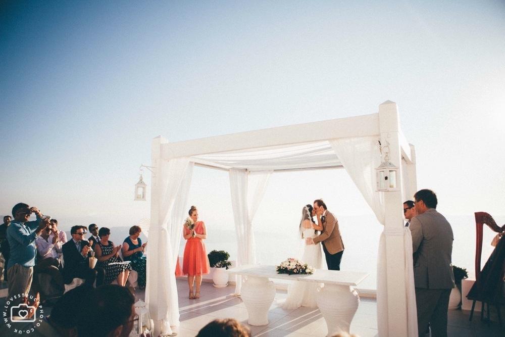 fira sunset wedding ceremony santorini, santorini sunset wedding ceremony, fira wedding photographer